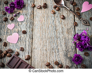 Decorations for Valentines day paper hearts, violets and chocolate coffee on rustic wooden background