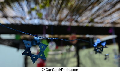 Decorations inside a Jewish Sukkah - Star of David...
