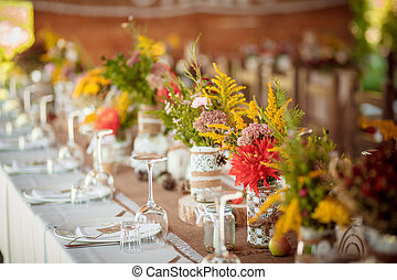 decorations made of wood and wildflowers served rustic -...
