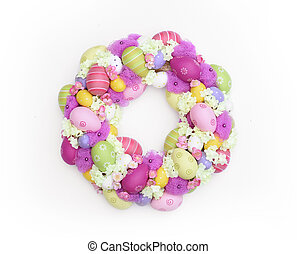 Decorative and colorful Easter wreath with pink and green eggs isolated on white background