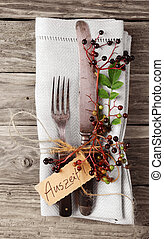 Decorative Autumn Table with vintage silverware and napkin