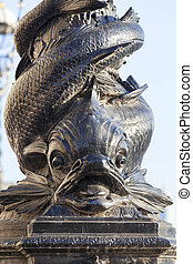 Decorative base of street lamp, boulevards on the river Thames near Westminster bridge, London, United Kingdom