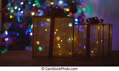 decorative boxes on the background of the Christmas tree