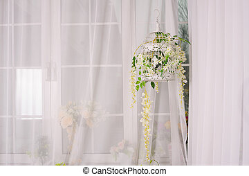 decorative cell with white flowers in the room