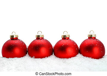 Decorative Christmas glass ornaments on the snow