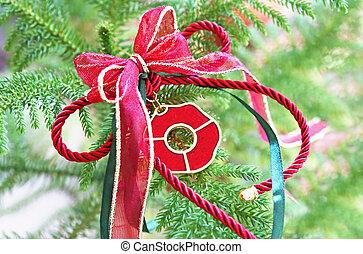 decorative Christmas lucky charm on green tree