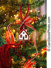 decorative Christmas lucky charm with red ribbons on the Christmas tree