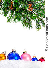 Decorative Christmas ornaments on the snow and Christmas tree.