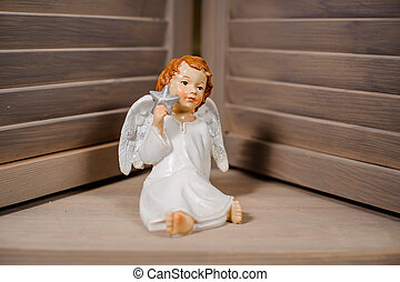Decorative Christmas toy in a form of the cute angel