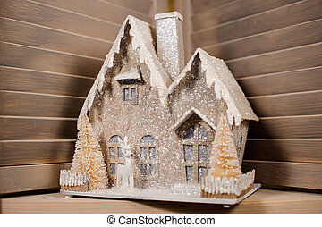 Decorative Christmas toy in the form of a house covered with snow