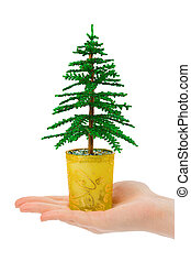 Decorative christmas tree in hand