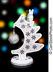 Decorative Christmas tree with a rat sitting upstairs on a dark background