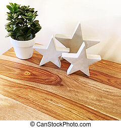 Decorative concrete stars and green plant on a table