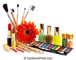 Decorative cosmetics and flower.