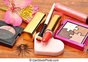 Decorative cosmetics and orchid flower