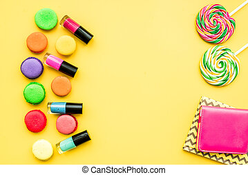 decorative cosmetics on yellow background top view