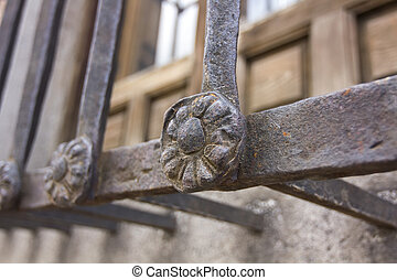 decorative details in an old iron fence