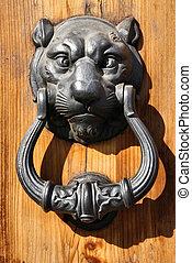 Lion head - vintage iron door knocker in Florence, Italy