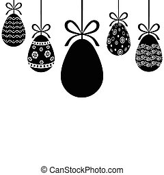 Decorative Easter eggs hanging on ribbons with bows