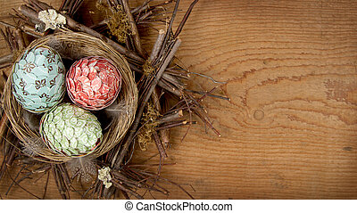 decorative easter eggs made of paper in nest