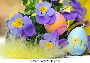 decorative eggs in flowers