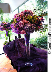 Decorative Flower Arrangements on Purple Tablecloth