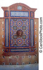 Decorative fountain head in old Tarifa, Andalusia