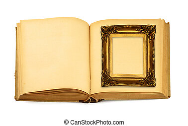 decorative frame lying on an open book isolated on white