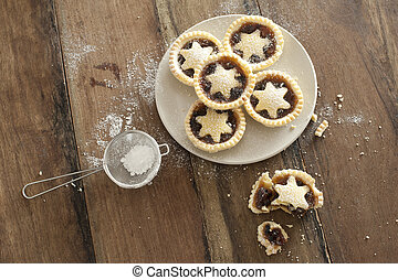 Decorative freshly baked Christmas mince pies - Overhead ...