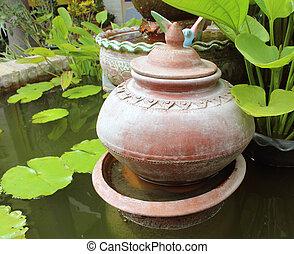 Decorative garden with terracotta pots.