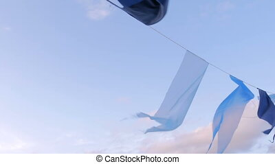 Decorative garland of satin flags waving in the wind -...