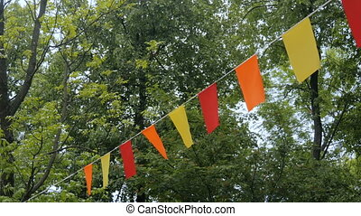 Decorative garlands of colorful rectangular flags