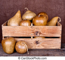 Decorative gourds in a crate