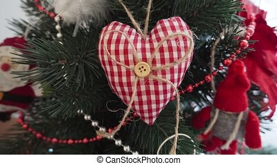 Decorative heart - Christmas decoration on the Christmas tree.