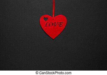 Decorative heart with the inscription love on a black background