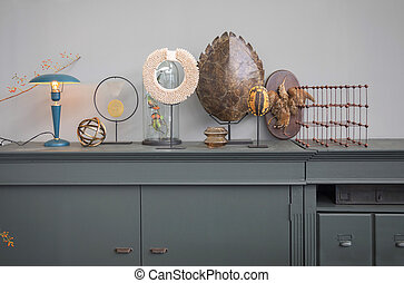 home objects on shelf in retro interior