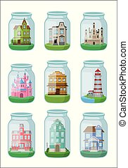 Decorative houses in glass jar on white background.