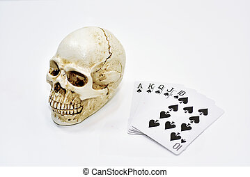 Decorative human skull with playing cards.