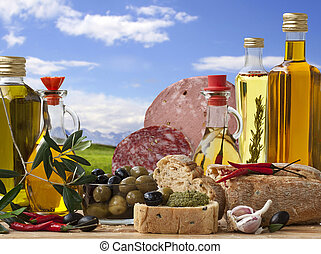 Decorative Italian deli with 5 different Olive Oil, Italian Bread, Italian Baloney and Salami, Olive and ingredient on a Landscape Background.