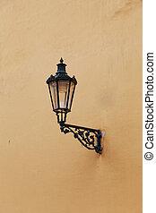 Decorative lamp on a brick wall