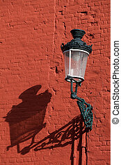 Decorative lamp on a red brick wall