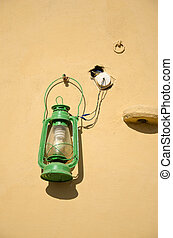 decorative lamp on old wall