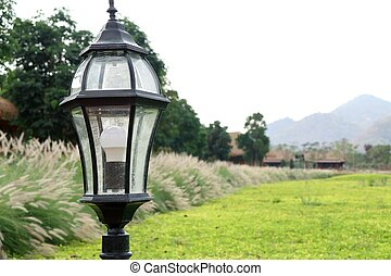 Decorative lamp pole in park