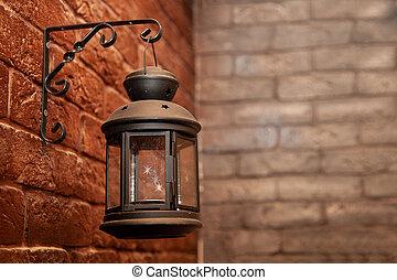 decorative lantern on a brick wall