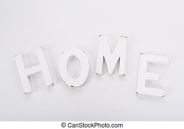 Decorative letters forming word HOME on white background. Rustic interior decor