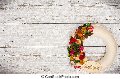 Decorative letters word home with dried flowers on wooden background