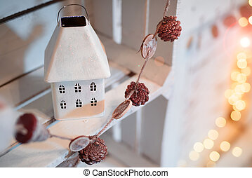 Decorative New Year's house made of metal.