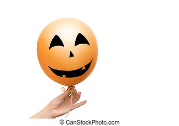 Decorative orange balloon for Halloween party on white background.