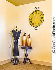 Decorative outfit, table, bottles and clock