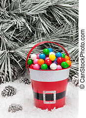 Decorative pail of Christmas gumballs - A decorative pail of...